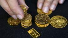 Gold ticks up on weaker dollar, U.S. stimulus hopes