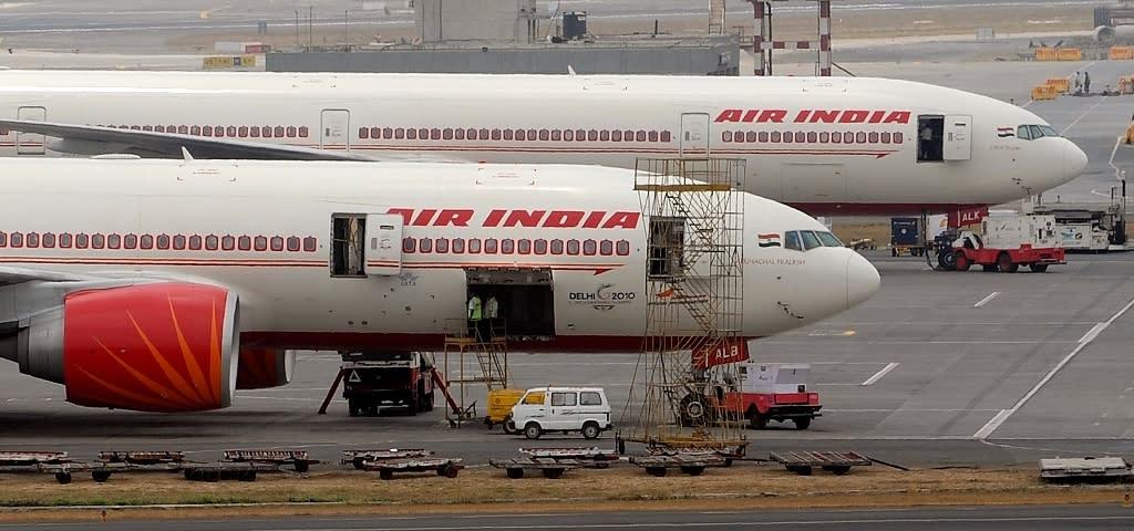 Air India aircraft are seen parked on the tarmac of Mumbai airport (AFP Photo/Punit Paranjpe)