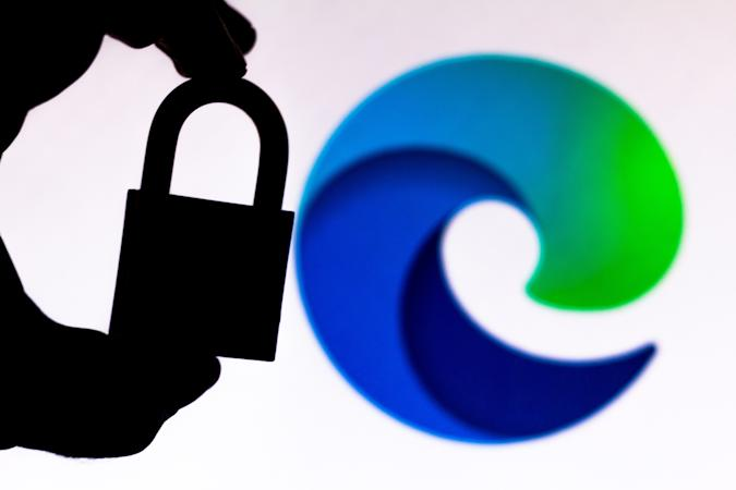 BRAZIL - 2020/07/11: In this photo illustration a padlock appears next to the Microsoft Edge logo. Online data protection/breach concept. Internet privacy issues. (Photo Illustration by Rafael Henrique/SOPA Images/LightRocket via Getty Images)
