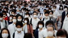 Tokyo may raise coronavirus alert as travel campaign comes under fire