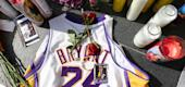 Fans placed flowers, candles and memorabilia for NBA legend Kobe Bryant outside the Staples Center. (Getty Images)