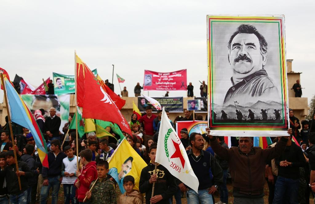 Kurdish protesters hold a portrait of Kurdistan Worker's Party jailed leader Abdullah Ocalan on February 14, 2016, during a rally in the northeastern Syrian city of Qamishli to mark the 17th anniversary of his arrest by Turkish agents (AFP Photo/Delil Soulieman)