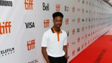 Hudson's Bay rolls out the official striped carpet at Roy Thomson Hall for the 43rd Toronto International Film Festival with Lamar Johnson, The Hate U Give