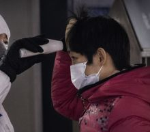 Grim Scenes at Chinese Hospitals as Doctors Rush to Treat Deadly Coronavirus