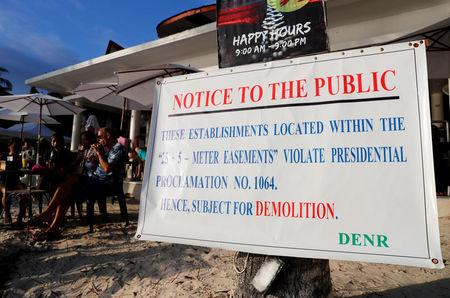 A government violation notice is pictured in front of an establishment that is due for demolition in Boracay in Philippines, April 8, 2018. REUTERS/Erik De Castro