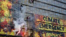 Climate activists use smoke and 'flames' on new EU building to warn of 'climate emergency'