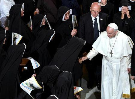 Pope Francis is greeted by nuns during a visit to the Sanctuary of Divine Mercy in Krakow, Poland July 30, 2016. REUTERS/Daniel Dal Zennaro/Pool