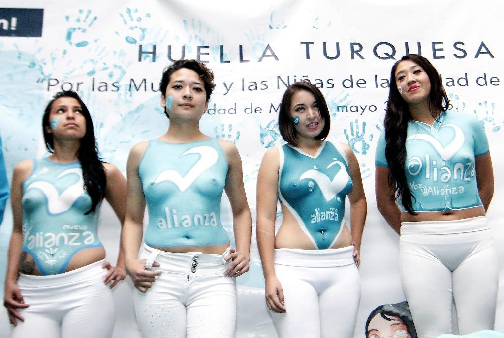 The New Alliance party came under fire after four women took part in a campaign event in Mexico City wearing only white pants and turquoise body paint, the party colors