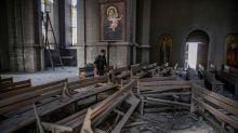 Devastation inside Karabakh church hit by rocket
