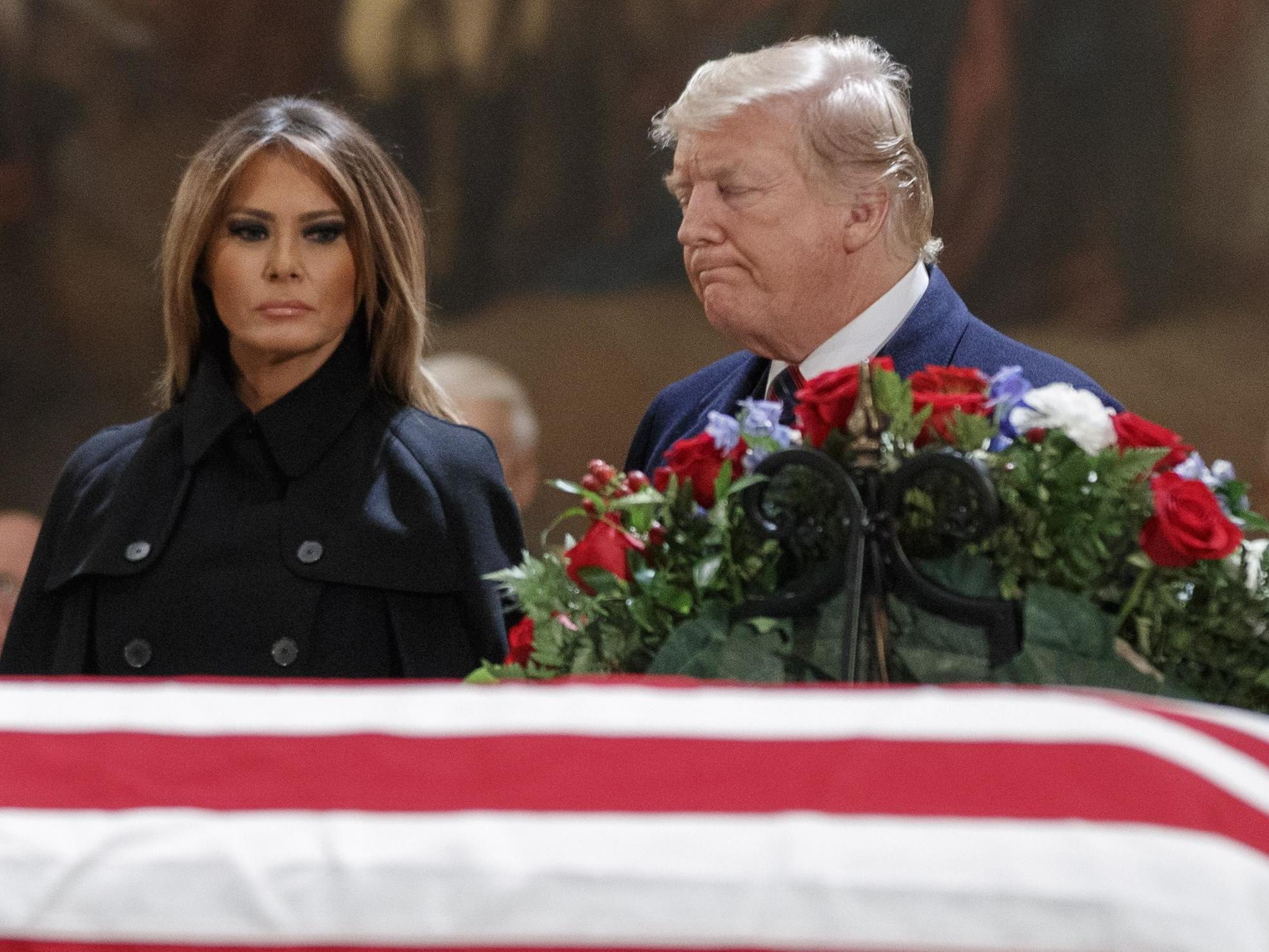 Donald Trump tweets about oil prices moments before George HW Bush funeral, which he says 'is not a funeral'