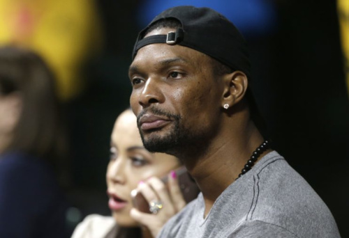 Two-time champion and 11-time NBA All-Star Chris Bosh could be a free agent soon, but at what cost? (AP)