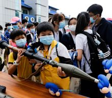 Hong Kong students invited to handle rocket launchers during day of pro-Beijing activities