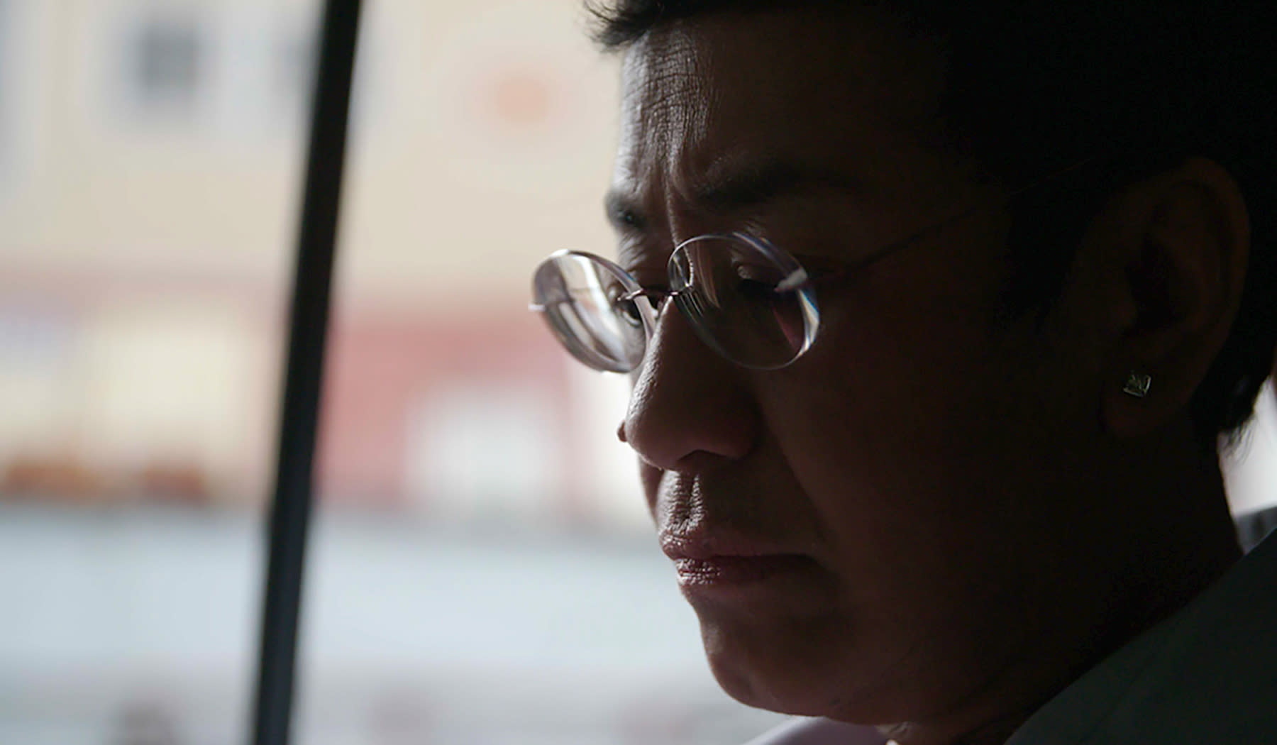 "This image provided by Frontline/PBS shows Filipino journalist Maria Ressa in a scene from the documentary ""A Thousand Cuts."" The documentary tracks Ressa's dual life in recent years. She's seen smiling while accepting international honors and praise from the likes of George Clooney, then grimly facing down online harassment, legal action and real world threats for her news site's reporting on the drug war waged by President Rodrigo Duterte. (Frontline/PBS via AP)"
