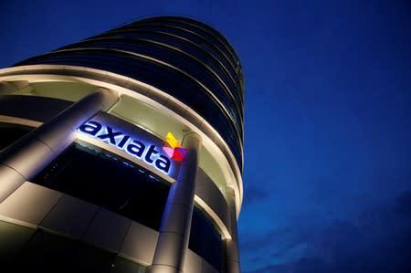 After big deal fails, Malaysia's Axiata seeks small sales