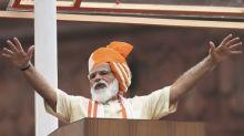 India's Modi defends new law as critics warn of risks to farmers