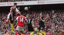 Man City twice blow a lead as Arsenal rescue point