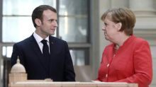 Macron, Merkel differ on fiscal policy in EU reform push