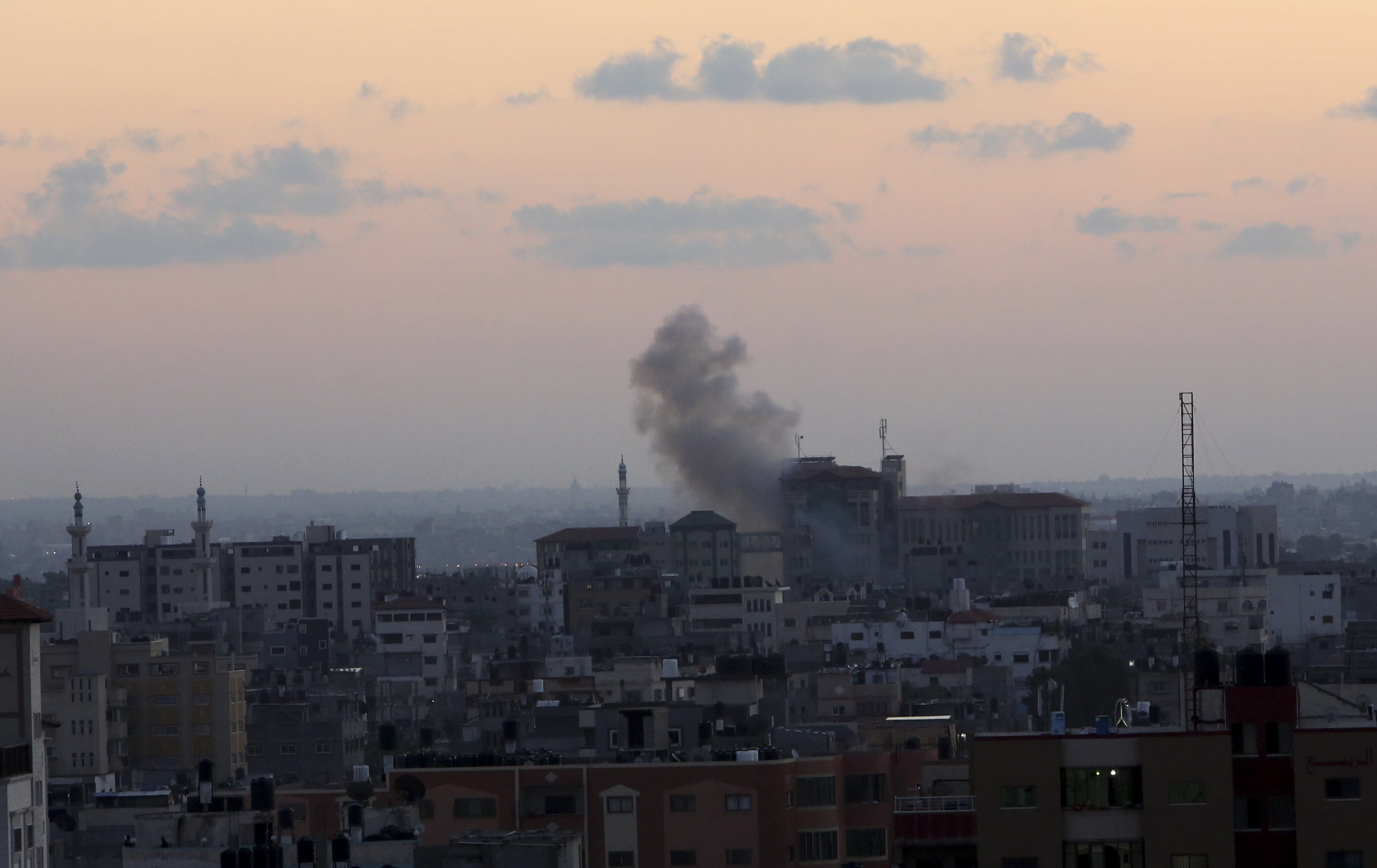 Smoke rises following Israeli strikes on Gaza City, Monday, Nov. 12, 2018. Palestinian militants on Monday fired dozens of rockets and mortar shells into southern Israel, critically wounding an Israeli teen, in an intense barrage of projectiles aimed at seeking revenge for a deadly Israeli military incursion late Sunday. The Israeli military responded by dispatching fighter jets to strike throughout the Gaza Strip. (AP Photo/Adel Hana) (AP Photo/Adel Hana)