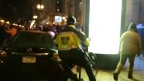 Boston Cops Stop Crowd Overturning Car