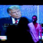 Trump votes early in Florida as Biden warns of COVID-19 'dark winter'