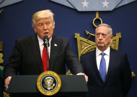 U.S. Defense Secretary Mattis listens to remarks by President Donald Trump at the Pentagon in Washington