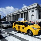 The Latest: NYC, California sue post office over cigarettes