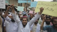 Thousands rally in Pakistan in support of killer of American