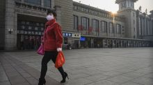 Asian markets pressured as number of new COVID-19 cases spikes in China