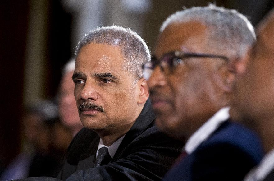 Attorney General Eric Holder, left, attends a ceremony on Capitol Hill in Washington, Wednesday, July 31, 2013, in observance of the 50th anniversary of the March on Washington for Jobs and Freedom. (AP Photo/Manuel Balce Ceneta)