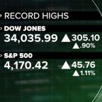 Stocks climb to record highs as economy begins to make a comeback