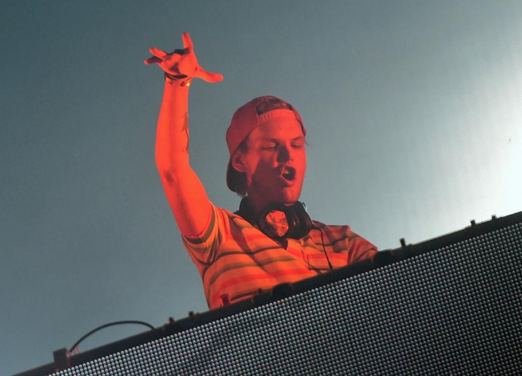 """Avicii came to define the new age of radio-friendly EDM in 2011 with """"Levels,"""" which entered the top 10 across Europe with its sample of soul great Etta James in between synthesizer riffs that soar with stadium-packing power (AFP Photo/Attila KISBENEDEK)"""