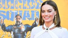 Margot Robbie Returns To The Red Carpet In Bridal White Jumpsuit