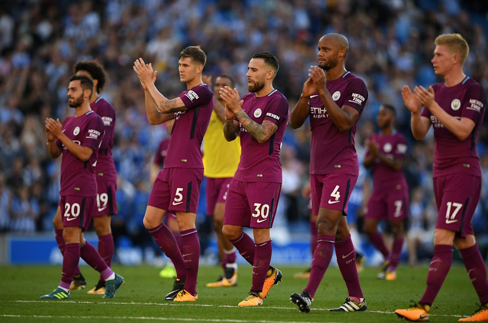 Manchester City's players salute the crowd
