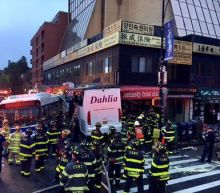 Three dead, 16 hurt after buses collide in New York City