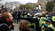 London protest: 16 arrests and officers injured as police shut down anti-lockdown rally after crowds break social distancing rules