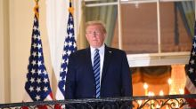 Trump faces backlash for removing mask on return to White House