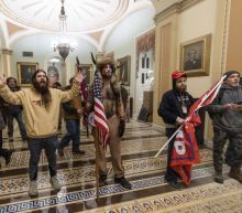 Alleged Capitol rioters argue Trump invited them in. They want pardons