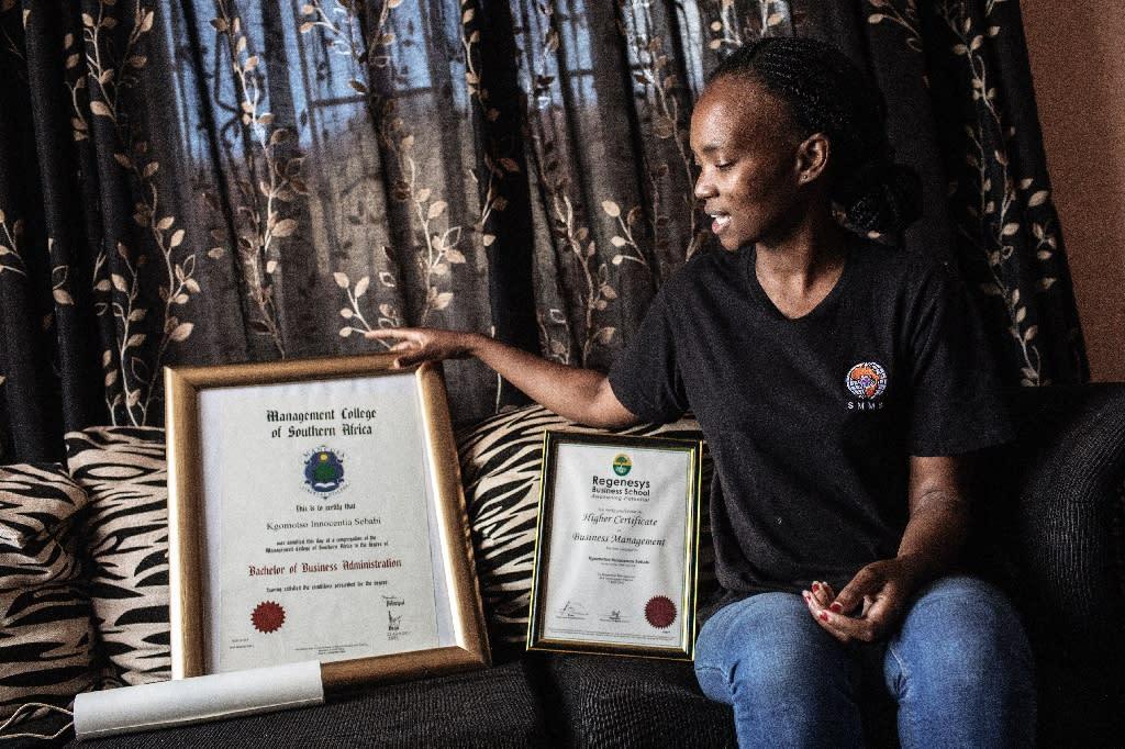 Kgomotso Sebabi, a South African unemployed graduate shows her higher education certificate (AFP Photo/GIANLUIGI GUERCIA)