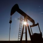 Oil climbs on Chinese factory data, U.S. stimulus hopes