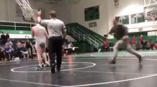 Father arrested after slamming teen during high school wrestling match
