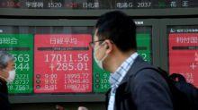 Mercados logran cerrar en verde tras masivas ayudas de gobiernos y bancos centrales