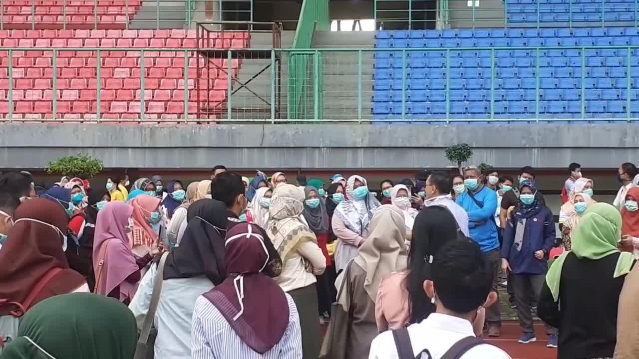 Crowds gather at soccer stadium for mass coronavirus ...