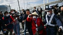 Passengers leave Japan virus ship, but new infections detected