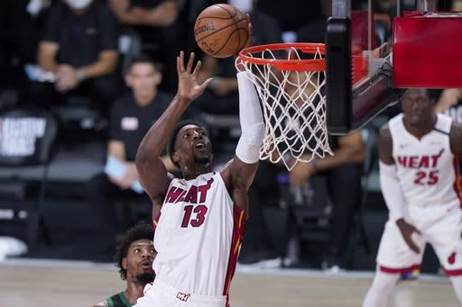 Miami Heat forward Bam Adebayo (13) goes up for a shot after getting past Boston Celtics guard Marcus Smart, left rear, during the first half of an NBA conference final playoff basketball game, Thursday, Sept. 17, 2020, in Lake Buena Vista, Fla. (AP Photo/Mark J. Terrill)