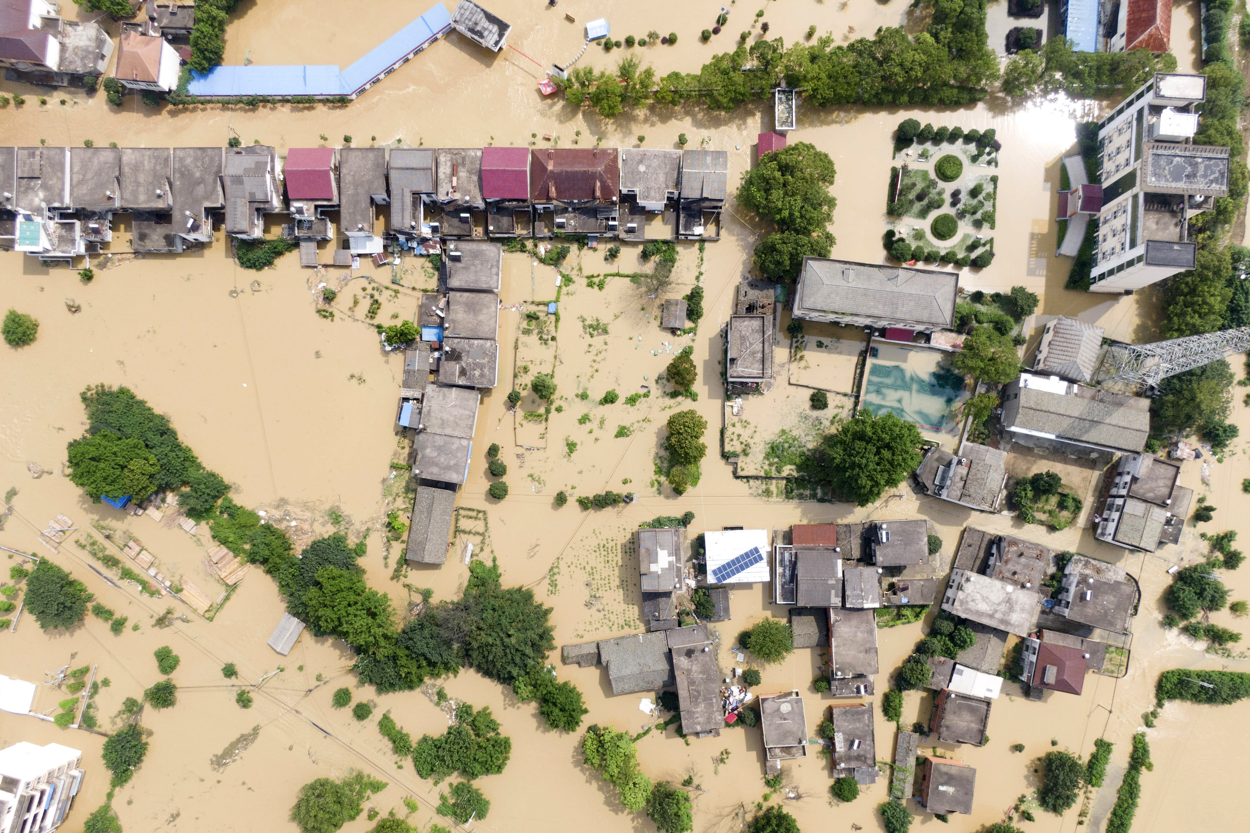 In this aerial photo released by Xinhua News Agency, a village is flooded in Sanjiao Township of the Yongxiu County in eastern China's Jiangxi Province Monday, July 13, 2020. Chinese authorities forecasted heavy rain across a wide swath of the country prompting evacuation of residents and raising emergency alerts levels. (Zhang Haobo/Xinhua via AP)