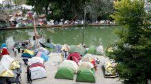 Virus threat stalks Paris migrant camps