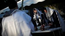In face of COVID-19 spike, New York Orthodox Jews take holiday prayers outside