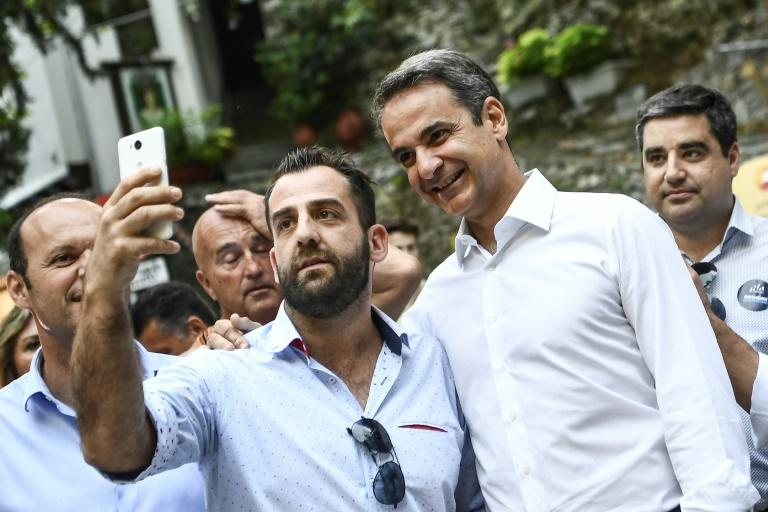 Mitsotakis was happy to pose for selfies during a campaign visit to Makrinitsa, in central Greece (AFP Photo/ARIS MESSINIS)