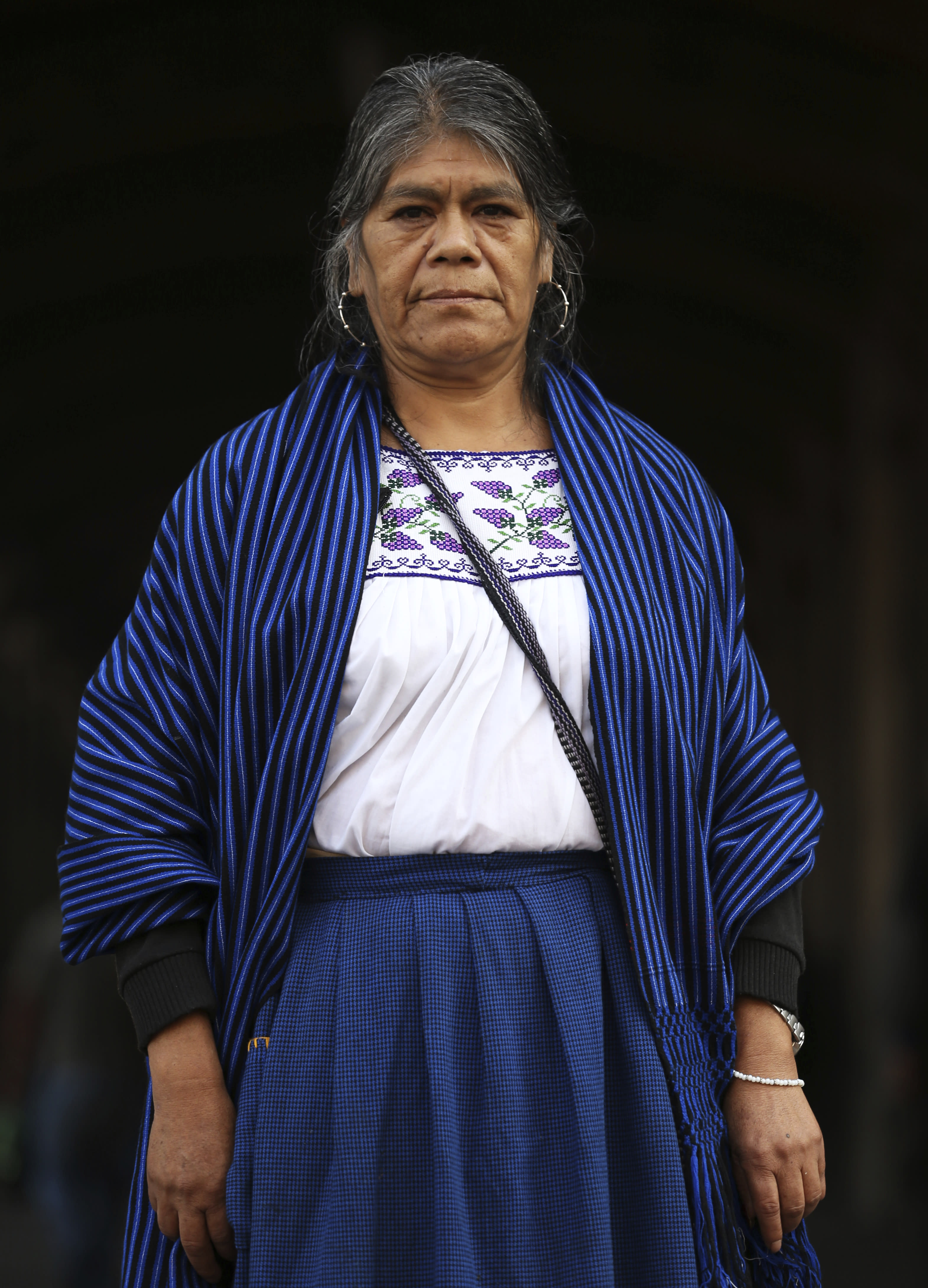 Maria Sara Guzman poses for a photo during an interview in the Zocalo in Mexico City, Friday, Nov. 29, 2019. An artisan from the Purepecha indigenous community of the state of Michoacan, Guzman says she already feels a bit disillusioned with Lopez Obrador. (AP Photo/Marco Ugarte)