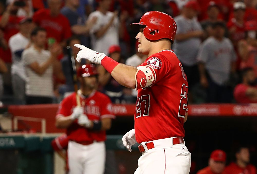 Mike Trout of the Angels points to the stands after hitting his milestone 200th career homer on Friday night. (Getty Images)